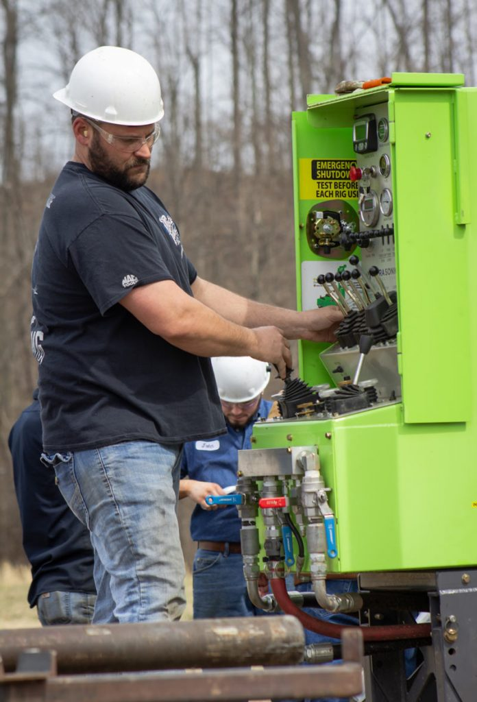 Master Sonic Driller at controls of Sonic Drill Rig