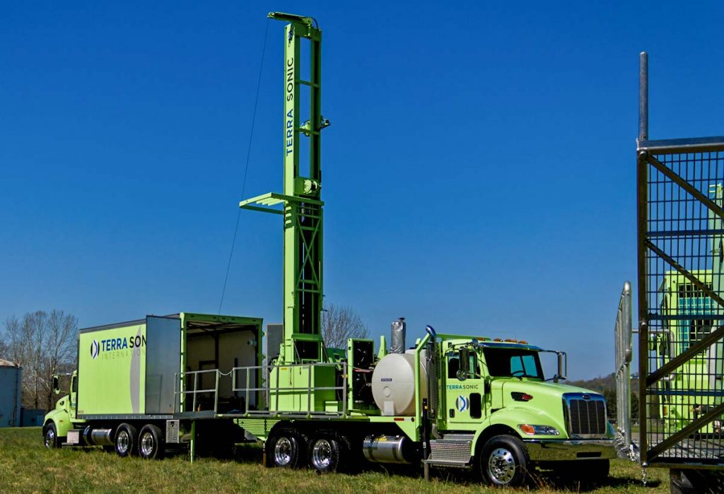 TSi Support Truck for sonic drill rig in use with sonic drill rig