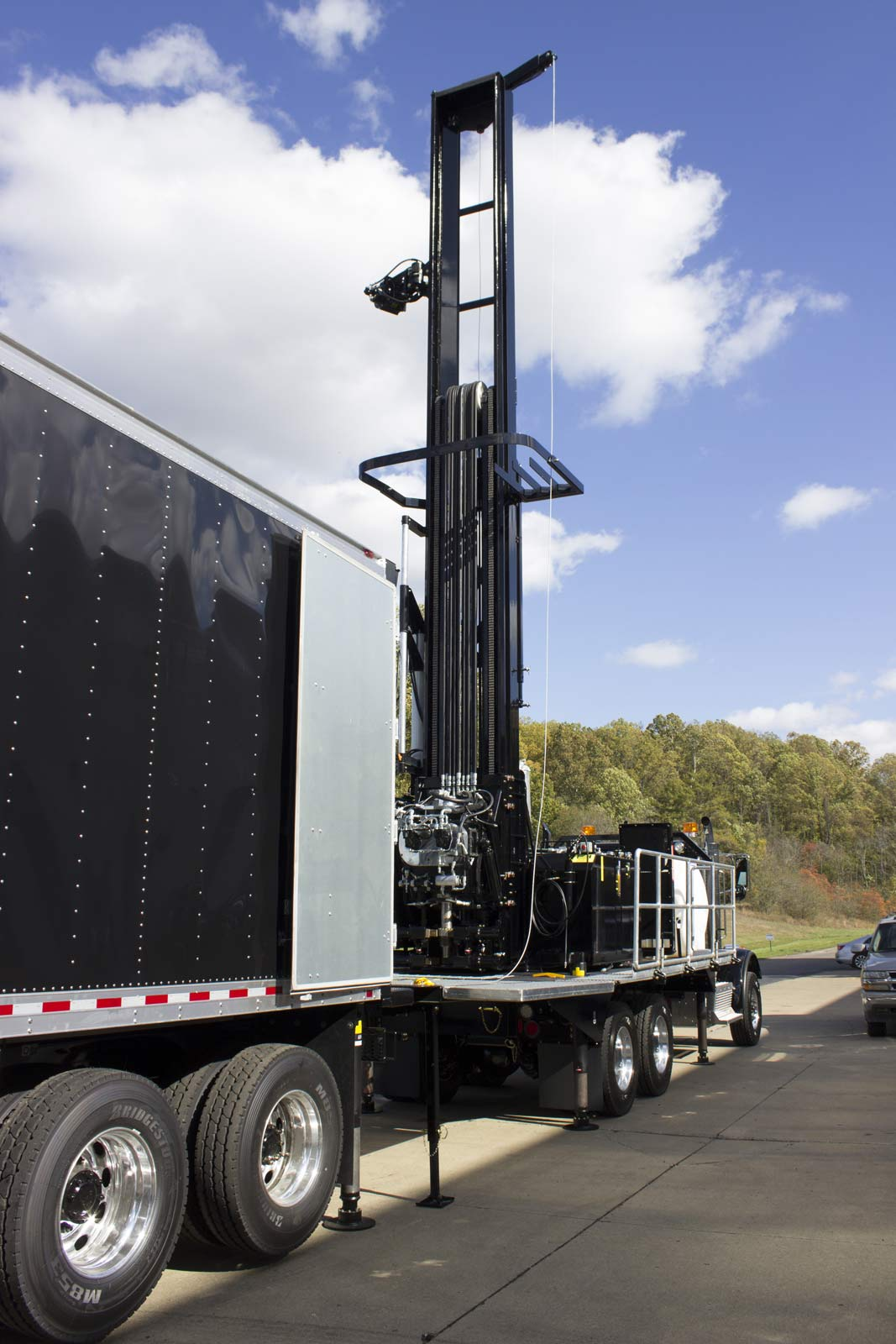Rear angle view of TSi 150T Sonic drill rig with support truck