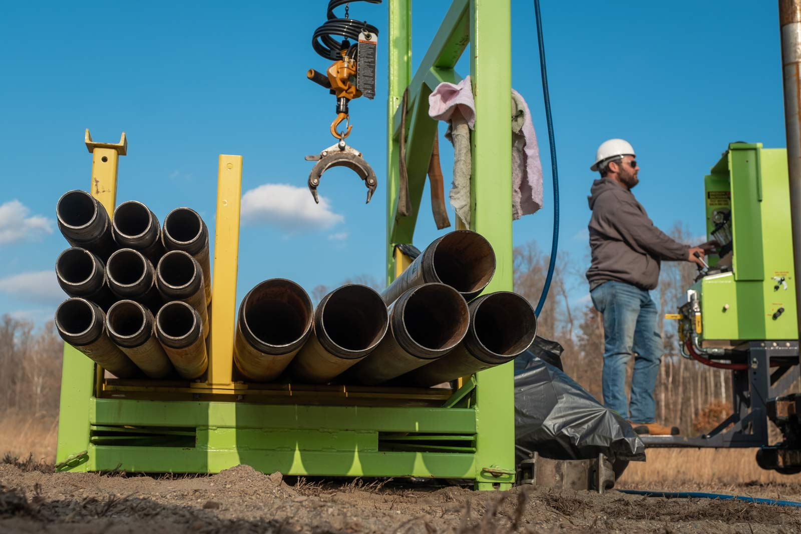 tug pipe handling system for sonic drill rig