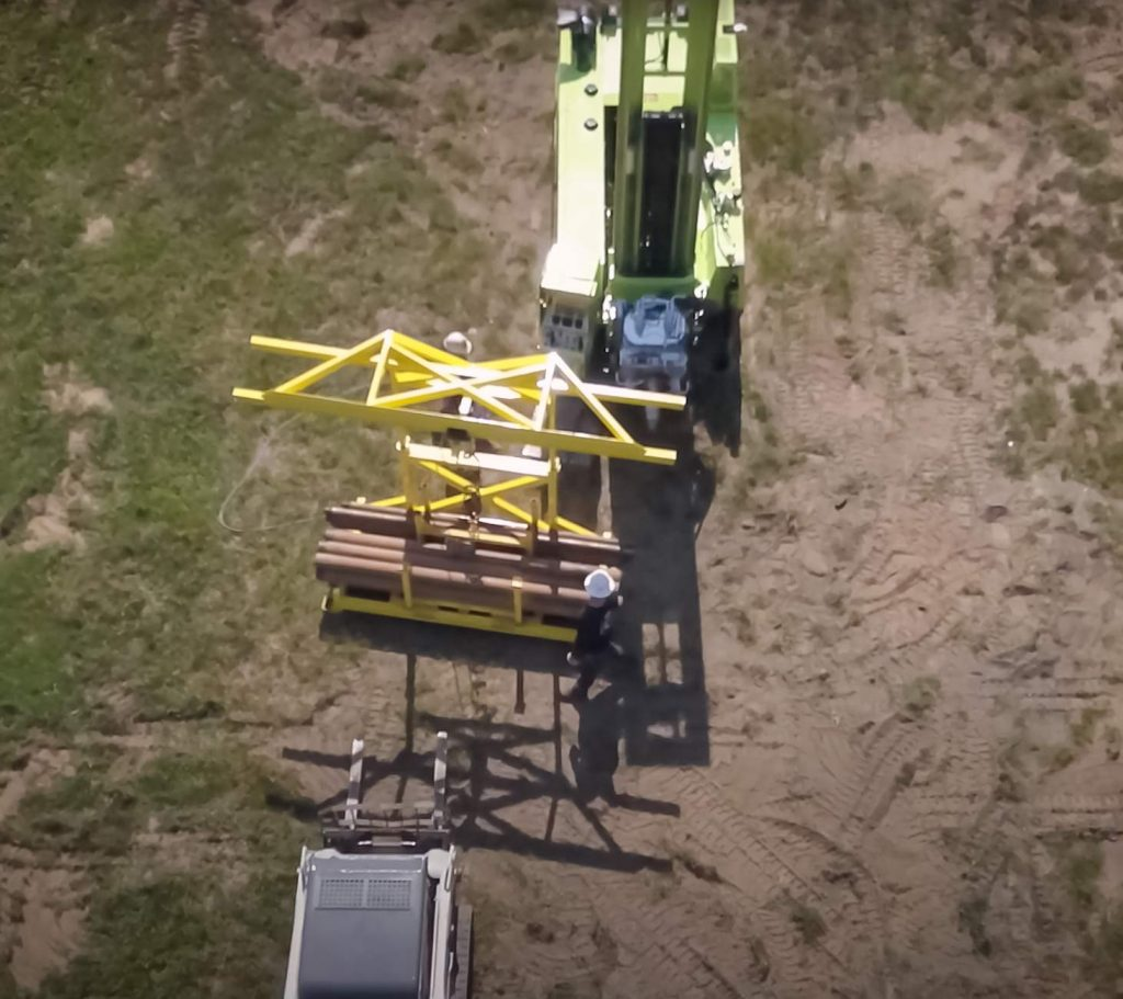 arial view of TUG pipe handling for sonic drill rig