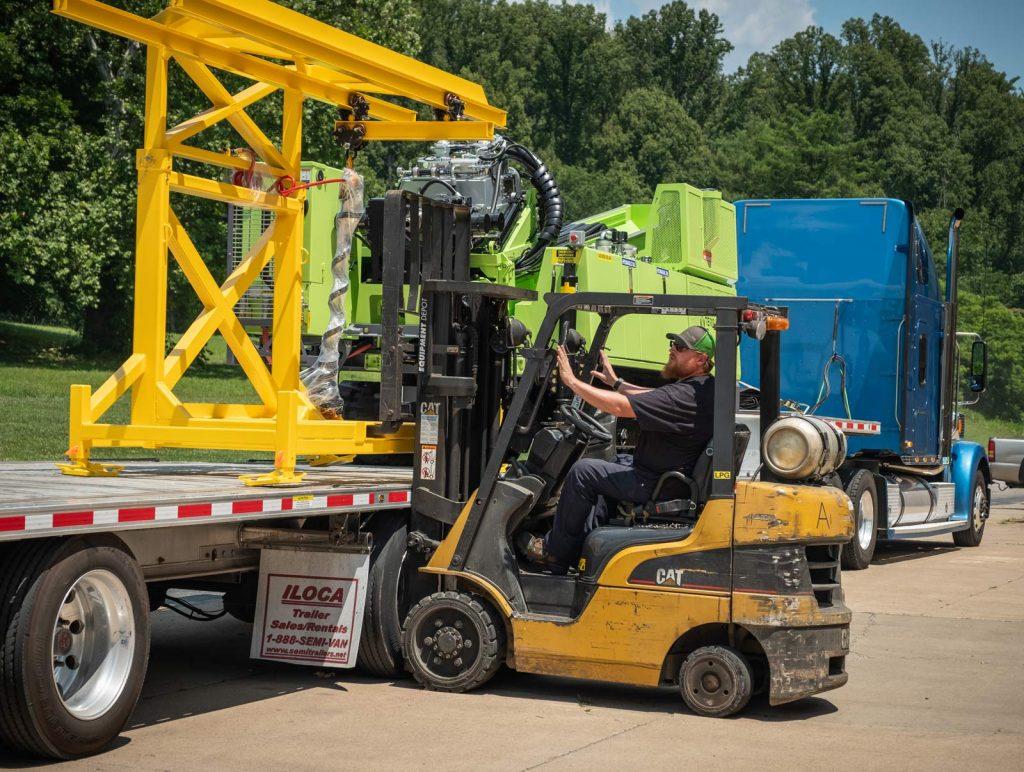 loading TUG pipe handling for sonic drill rig